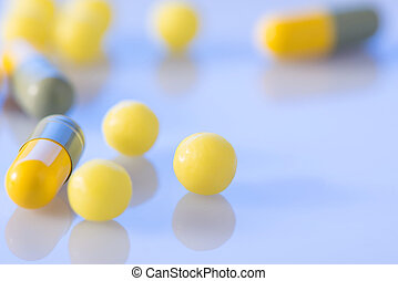 Coloured pills of different shape on the surface - Pills and...