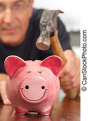 Withdraw - A man with a hammer is about to break a piggy...