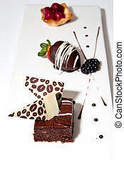 Fancy Custom Deserts on a White Board - Three custom deserts...