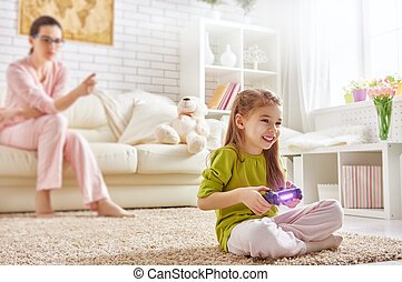 child playing video games - happy child girl playing video...