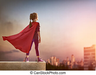 girl plays superhero - Little child girl plays superhero...