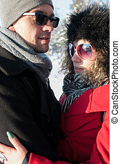 Young couple embracing. Outdoors winter