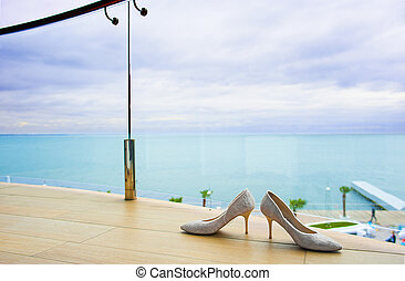 Bridal shoes near the fencing. - Cute bridal shoes are...