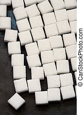 white sugar cubes - close up image of white sugar cubes