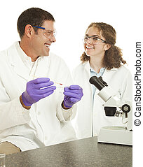 Happy Lab Technicians - Two lab techs enjoy working on a...