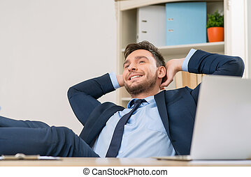 Overjoyed office worker sitting at the table - Time for...