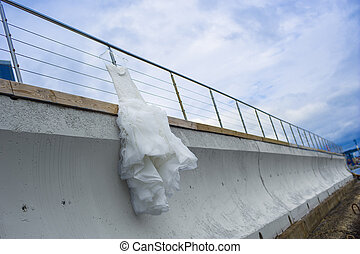 Nice bridal dress is hanging on the pier fencing - Beautiful...