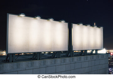 Two big empty billboard on the background of the city at night, mock up