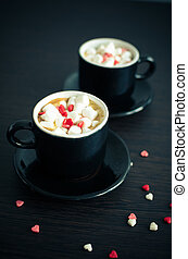 Coffee with marshmallow and small hearts. - Two cup of...