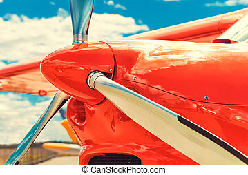 Propeller of a red airplane at the airport - Detail of the...