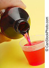 Cough Syrup - A bottle pouring cough syrup into a container...