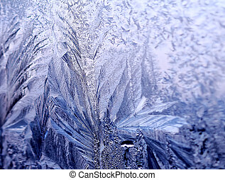 Icy ornate pattern of thin ice on the window