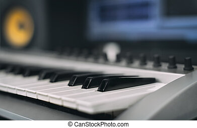 Midi keyboard. Home recording studio with professional monitors.