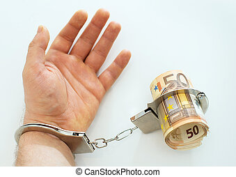 Hand with handcuffs and money. Bribery concept.