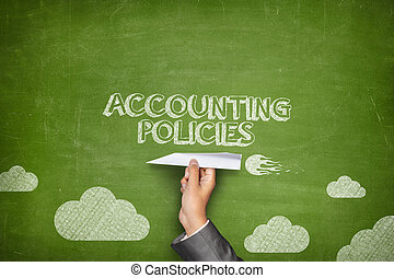Accounting policies concept on blackboard with paper plane -...
