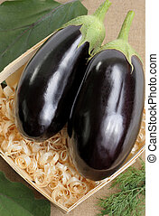Eggplants - Two eggplants of black colour in a basket