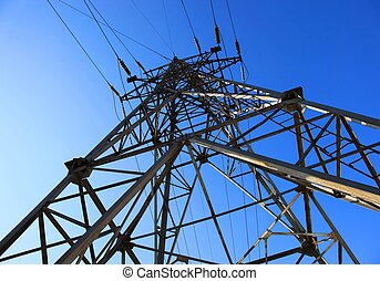Electricity pylon against blue sky. Close up.