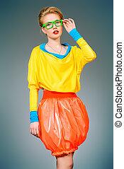 eyewear - Glamorous fashion model posing in vivid colourful...