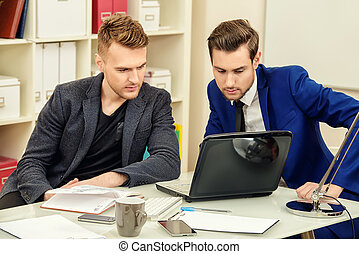 male colleagues - Colleagues businessmen discussing working...