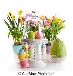 Easter eggs on cake stand with spring flowers