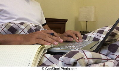 Businessman hands working on laptop typing making note handwriting pen