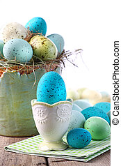 Easter scene with turquoise speckled egg in cup - Festive...