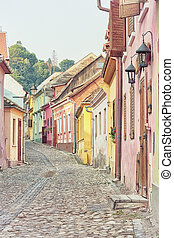 Sighisoara street, toned image - Picturesque city of...