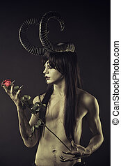 Where wild roses grow - Horned devil with red roses over...