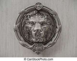 Lion Head - Metal lion head carving on marble slab
