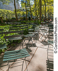 Bryant Park - Green folding chair at Bryant Park in...