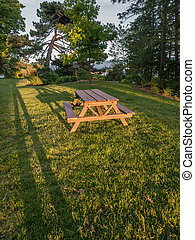 Picnic Table - Picnic table at sunset with long shadows on...