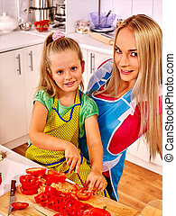 Mother and daughter cooking at kitchen - Mother with her...