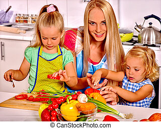 Mother and daughter cooking at kitchen - Mother and her two...