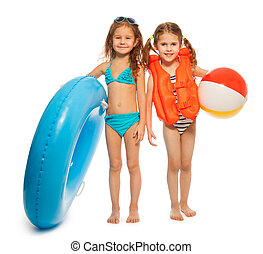 Two little swimmers with rubber ring and wind-ball