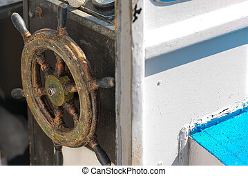 Old Wooden Helm Wheel - Detail of an old wooden helm wheel...