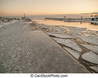 Oakville Lighthouse - Ice covered pier and Lake Ontario and...