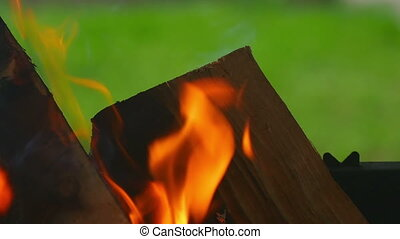 Wood burning, slow motion - Wood burning in the brazier,...