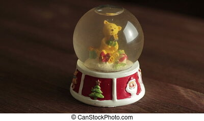 christmas snow globe with a santa claus - closeup of a...