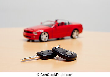Car key with silhouette of a convertible cabriolet car in...