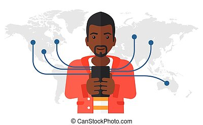 Man using smartphone - An african-american man holding...