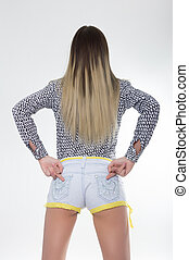 Sporty girl in jeans shorts with fit ass show two middle...