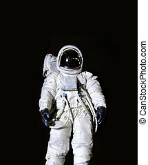 Astronaut against a black background - Astronaut wearing...