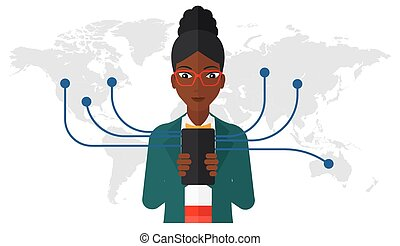 Woman using smartphone - An african-american woman holding...