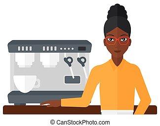 Barista standing near coffee maker - A barista standing near...