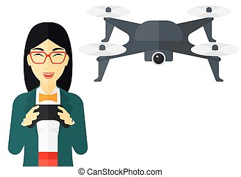 Woman flying drone - An asian woman flying drone with remote...