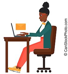 Woman receiving email. - An african-american woman sitting...