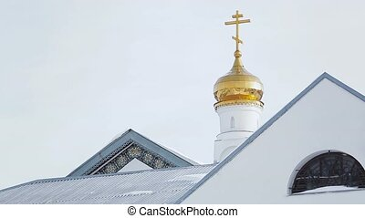Golden crosses on the top of church. Winter