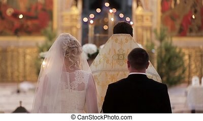 Bride and groom at the church during a wedding ceremony. HD