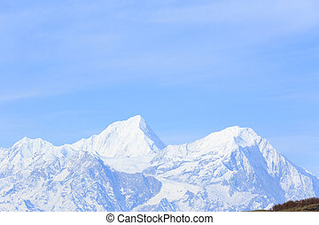 beautiful landscape of snow mountain under blue sky