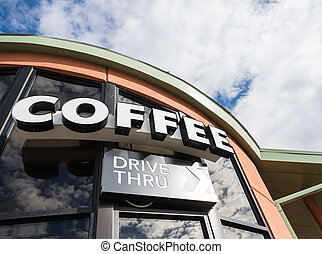 Coffee drive thru sign with cloudy sky